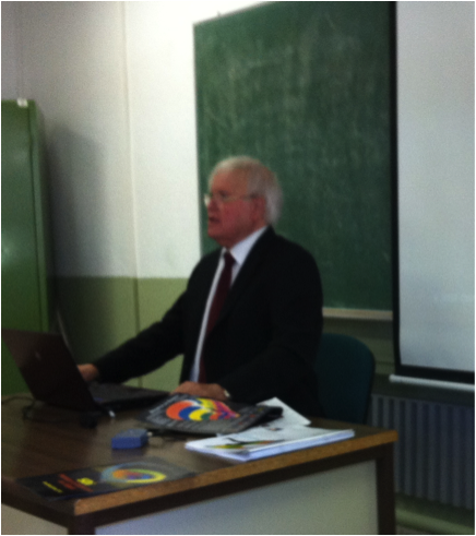 Picture 7: Dr. Beck delivering the conference at the University
