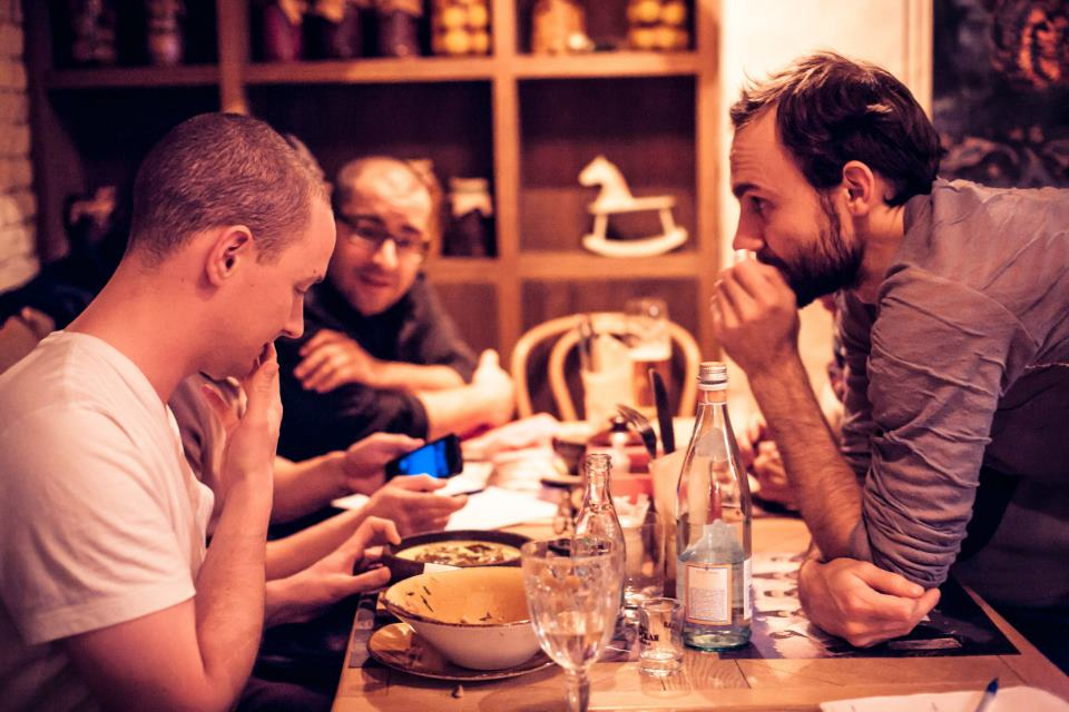 """Afterparty"" dinner at a Georgian cuisine restaurant. Colin Bigelow (left), Clint Fuhs (background), Dmitry Baranov (right)"
